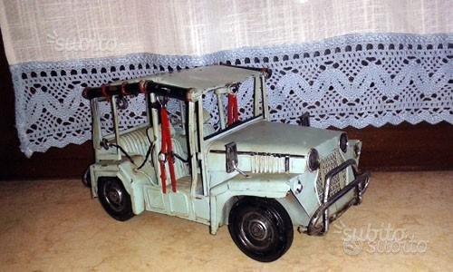 Auto vintage in latta