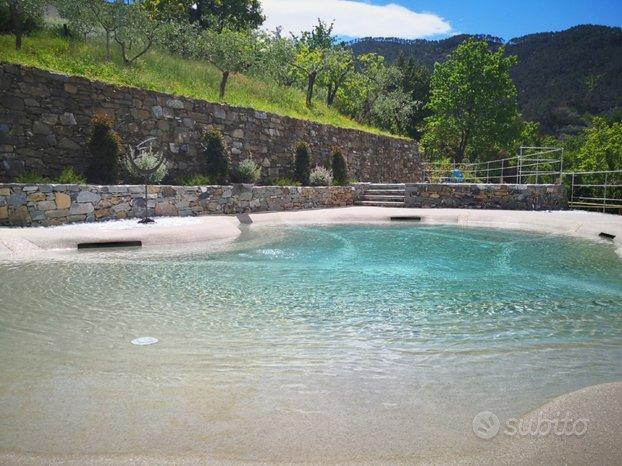 Bilocale con giardino e uso piscina (2/4 pers)