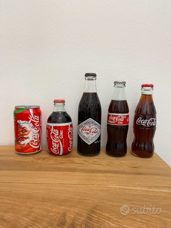 Bottiglie e lattina di Coca Cola anni 90'