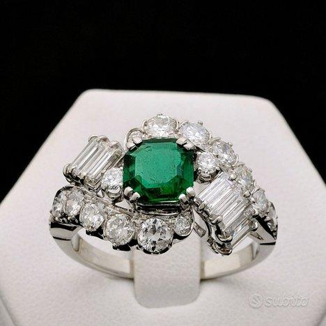 Anello enigma oro18kt smeraldo e diamanti 2.76ct