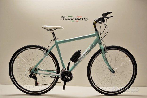 Bici ibrida 28 uomo alluminio shimano ammortizzata