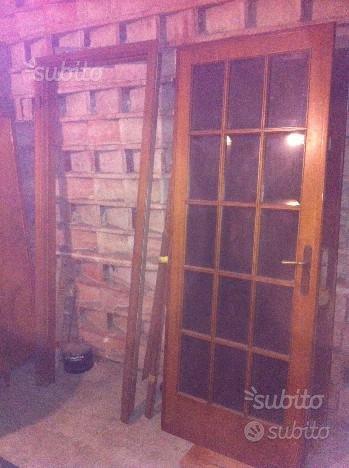 Porta di legno battente a vetri con legno interno