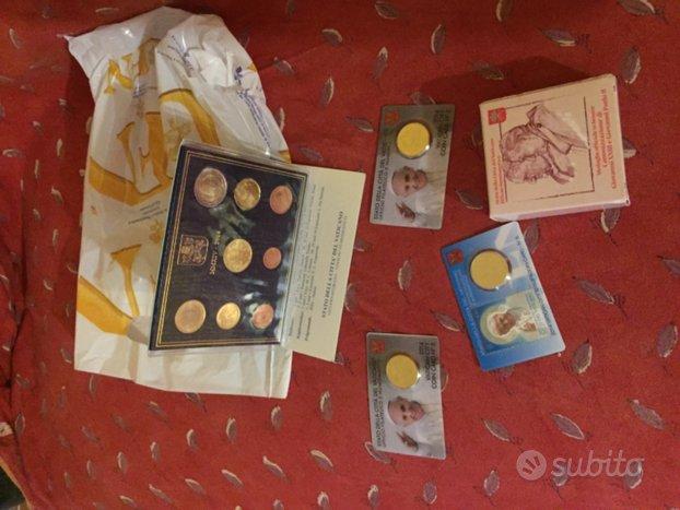 Monete e francobolli della città del Vaticano