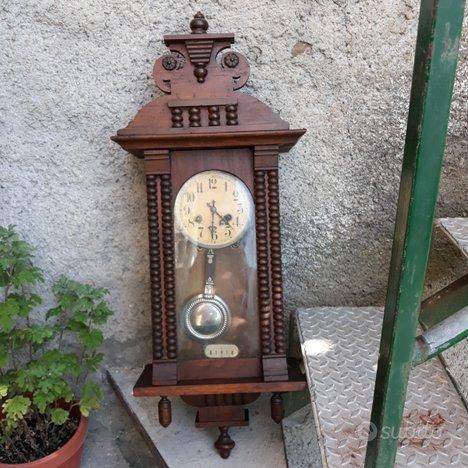Orologio a pendolo da muro in legno