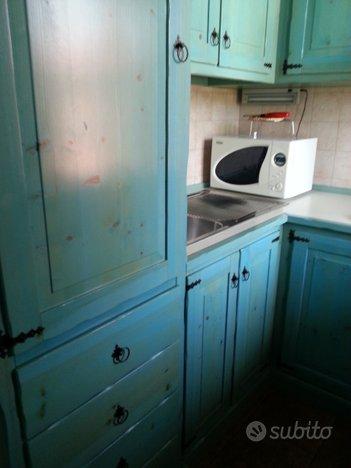 Cucina e camere in legno