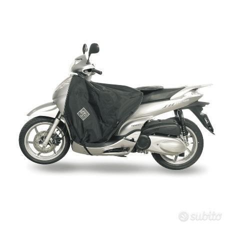 R064 nuovo - coprigambe tucano honda sh300