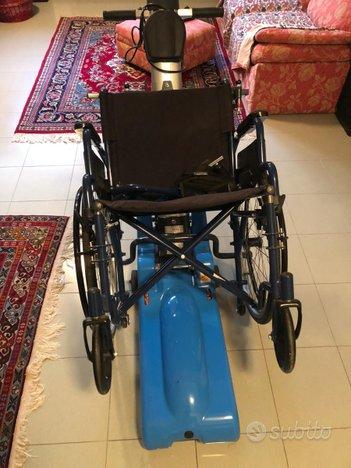 Montascale a cingoli con sedia a rotelle - Altri In ...