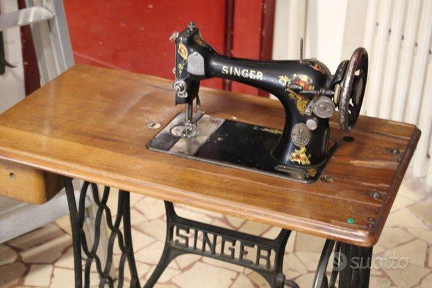 Antica macchina da cucire singer con mobile e cope