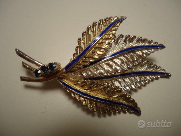 Spilla vintage placcata oro e argento con zaffiri