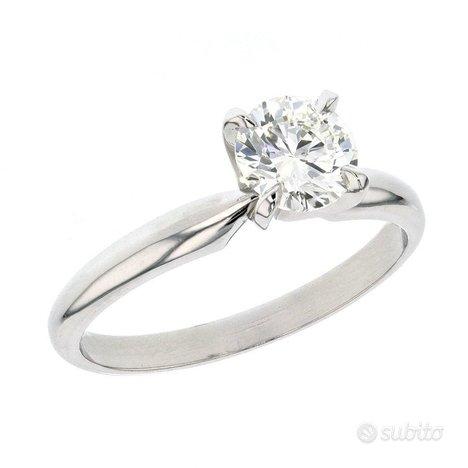 Anello Oro Bianco : Diamante 0.60 KT Naturale Cert