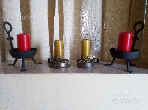 Due set portacandele in ferro battuto e ferro