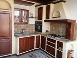 Cucina in muratura EXPO' in legno di castagno
