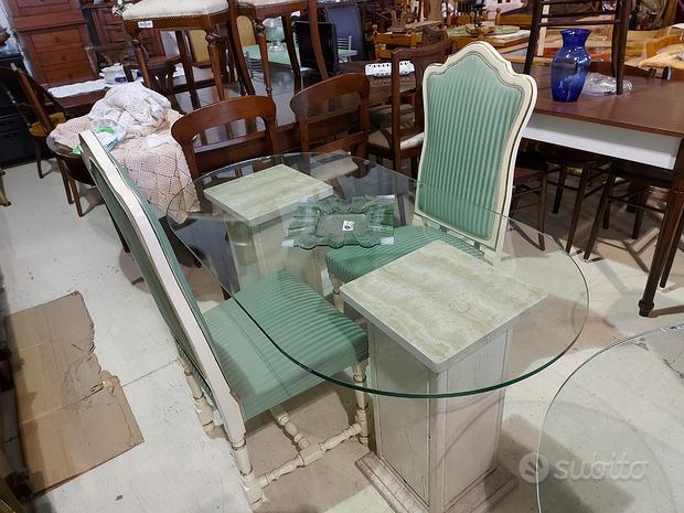 Tavolo in cristallo capitelli in travertino marmo