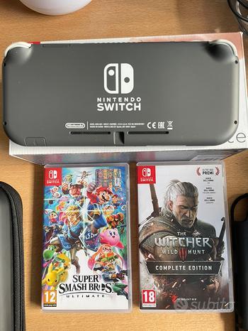 Nintendo switch lite + cover+ custodia + giochi