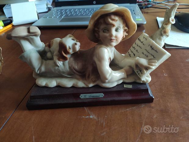 Statuina porcellana Capodimonte: ragazzo con cane