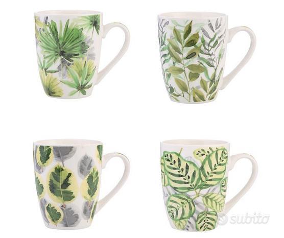 Tazza in ceramica bianca con foglie dipinte