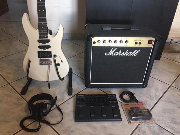 Chitarra, amplificatore, pedaliera, cuffie, accord