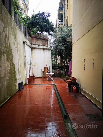 Appartamento con giardino e terrazzo
