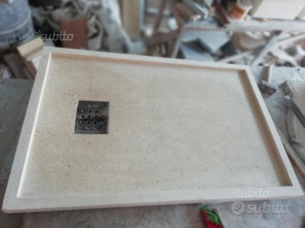 Lavandini piatti doccia e pietre mosaico