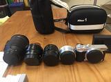 Nikon 1 J5 set completo macchina e 4 obiettivi